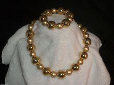Buy Gold Tone Bead/Strand choker style Necklace & stretch Bracelet