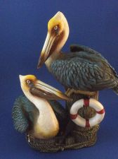 Buy Two pelicans on a post