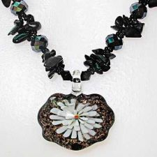 Buy FLORAL GLASS NECKLACE WITH A BLACK STONE AND CRYSTAL.