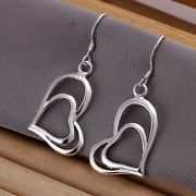 Buy Heart Shape Silver Plated Dangle Earrings