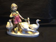 Buy antique porcelain. Capodimonte Girl with geezes. Marked Crown + S