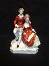 Buy antique porcelain. Lord and Lady in red. Marked with 2 marks.
