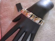 Buy Womens Silver tone Bunny in an Egg stretch bracelet # 71
