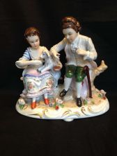 Buy antique porcelain . German Couple with goat