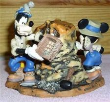 Buy Disney Goofy, Mickey, Pluto dinosaur Clock Figurine