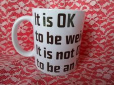 Buy be weird mug