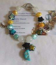 Buy star and moon blue black and yellow handmade bracelet sizing available