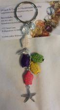 Buy turtle dolphin starfish and shell multi-colored handmade keyring