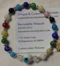 Buy evil eye millefiori glass multi-colored handmade bracelet sizing available
