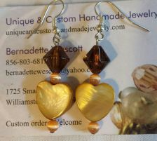 Buy heart brown mother of pearl,cat's eye and glass handmade earrings