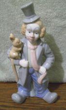 Buy Excellent condition PS Design clown figurine holding a rabbit.
