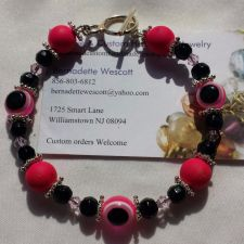 Buy evil eye pink and black handmade bracelet silver plated sizing available