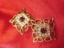 Buy Lady's Ear Rings -Red faceted stone surrounded by cubic zirconium & gold trim!!