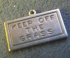 "Buy vintage CHARM : UNMARKED SILVER : READS ""KEEP OF THE GRASS"""
