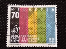 Buy Switzerland 1V USED STAMP 1998 Human Rights Face & 5 colored beams symbolisin