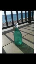 Buy turquoise colored bottle with topper