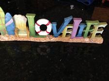 Buy love life ceramic free standing beach art