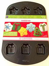 Buy New Wilton Christmas Cookie Pan 12 Cavities Non-Stick Snowflake Star Gift Tree