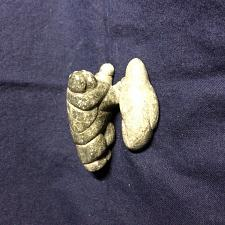 "Buy Inuit Art soapstone Carvings: Tiny Carving of resting Inuk beside Seal. 2""; 1"""