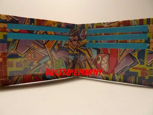 HAND MADE DUCT TAPE WALLET WITH GRAFFITI ALL OVER IT