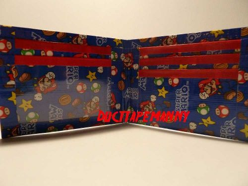 HAND MADE DUCT TAPE WALLET WITH SUPER MARIO BROTHERS ALL OVER IT