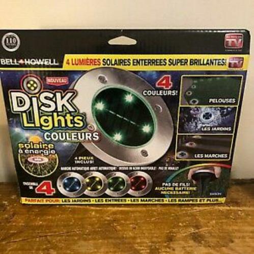 DISK LIGHTS 4 PC SET LED SOLAR INGROUND LIGHTS.....COLORED LIGHTS