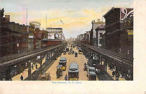 The Bowery, NY City with View of Elevated Trains Vintage Postcard
