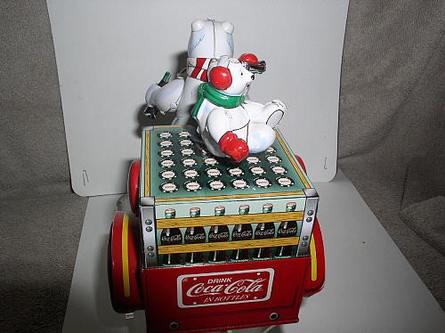 Motorcycle with Polar Bear Tin wind up Coca-Cola toy with original key