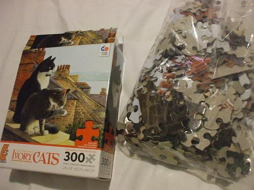 Lesley Ann Ivory's Ivory Cats on the ledge Ceaco Puzzle