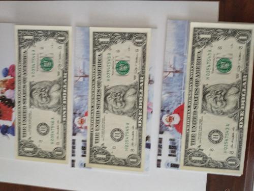 3 Santa Claus $ 1 dollar bill