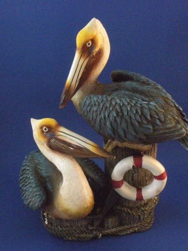 Two pelicans on a post