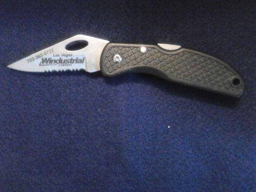 Las Vegas Windustrial Company 7in folding knife w/serrated edge & locking blade