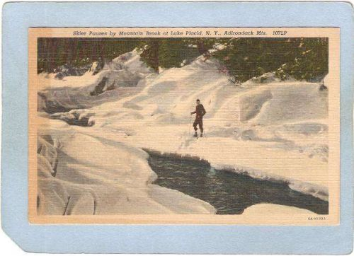 New York Lake Placid Skier Pauses By Mountain Brook ny_box5~1749