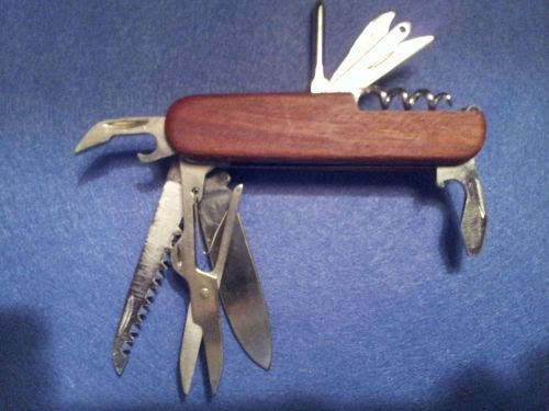 SWISS STYLE STAINLESS STEEL KNIFE - Lifelong Warranty - 13 Tools N One!