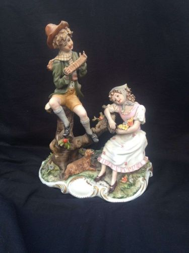 antique porcelain. CAPODIMONTE boy and girl. Marked + signed Ester
