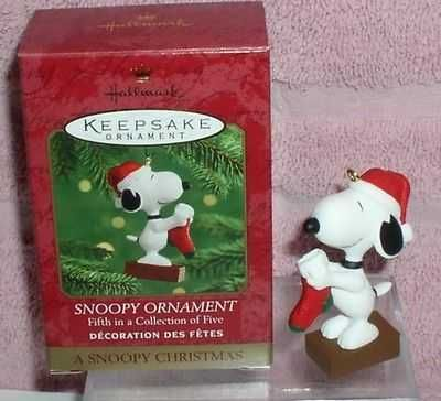 Snoopy holding a stocking to hang Miniature ornament
