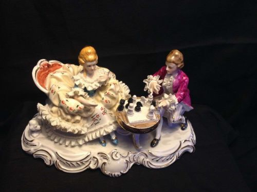 antique porcelain group - figurine Couple playing chess. Marked TKN