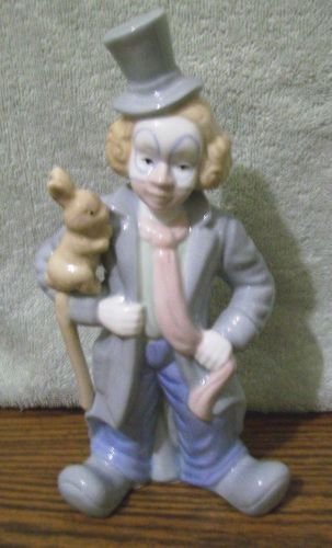 Excellent condition PS Design clown figurine holding a rabbit.