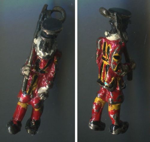 Vintage Enamel Charm Beefeater Guard Tower of London are called Yeoman Warders