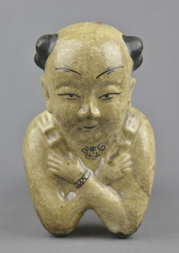 A RARE MING DYNASTY CIZHOU WARE CERAMIC IN THE FORM OF A BOY